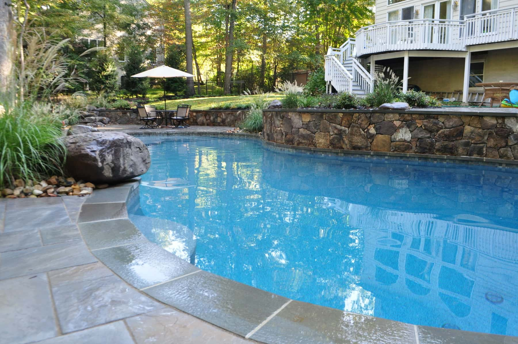 freeform pool, natural stone pool decking - annapolis, md