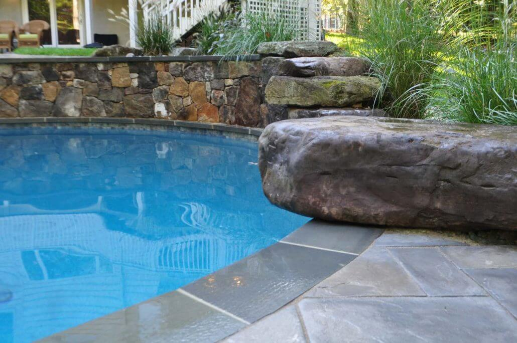 Custom Freeform Pool With Natural Stone Pool Decking
