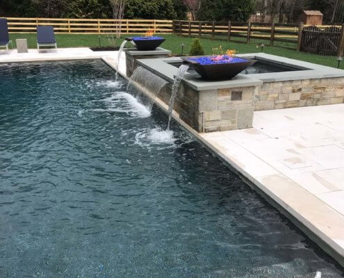 Pool And Spa With Custom Water Feature