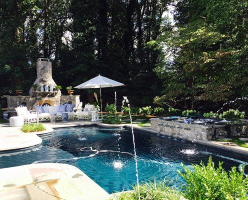 Pool With Spa And Natural Stone Fireplace