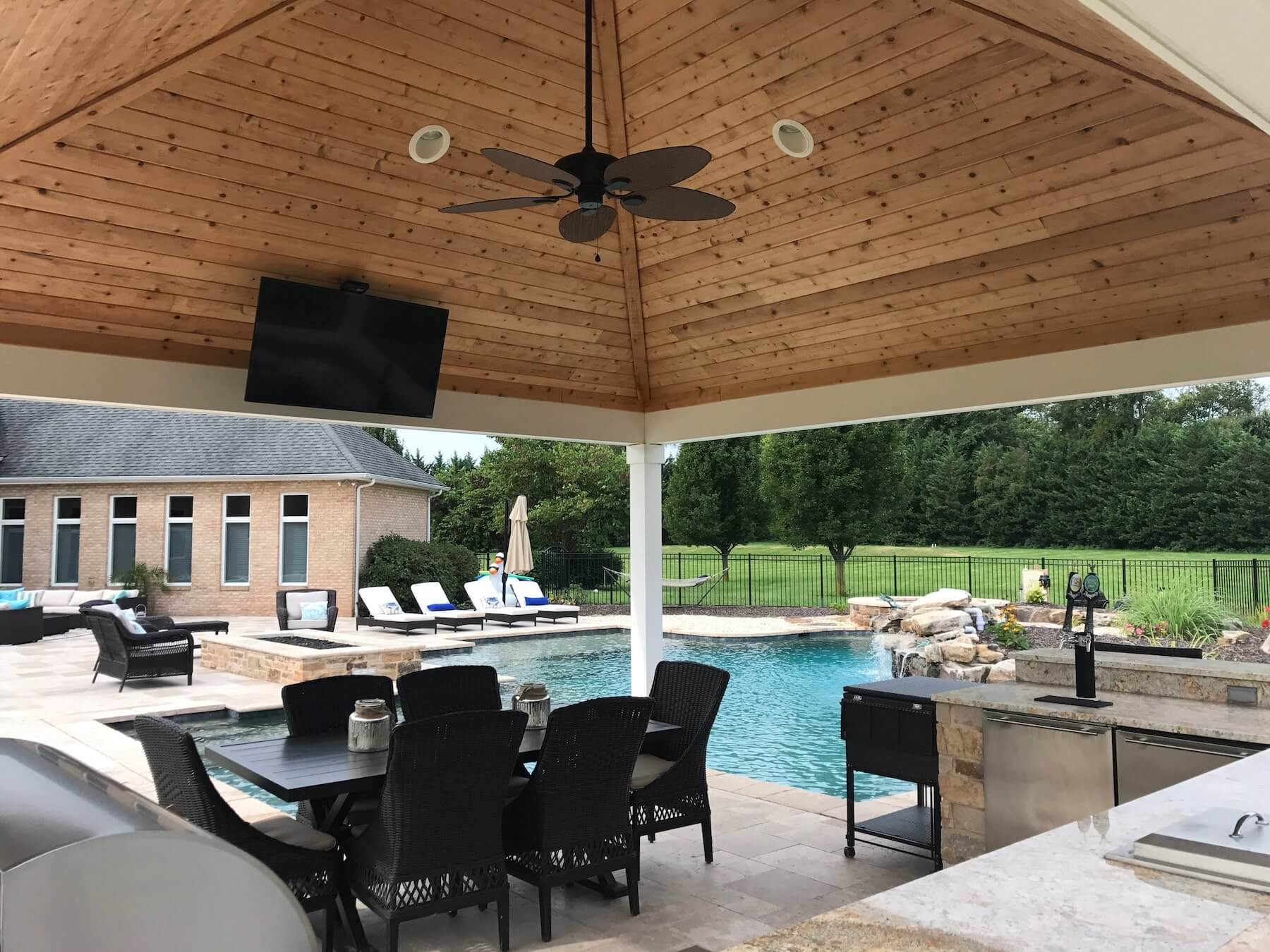 Poolside Pavilion With TV And Outdoor Dining