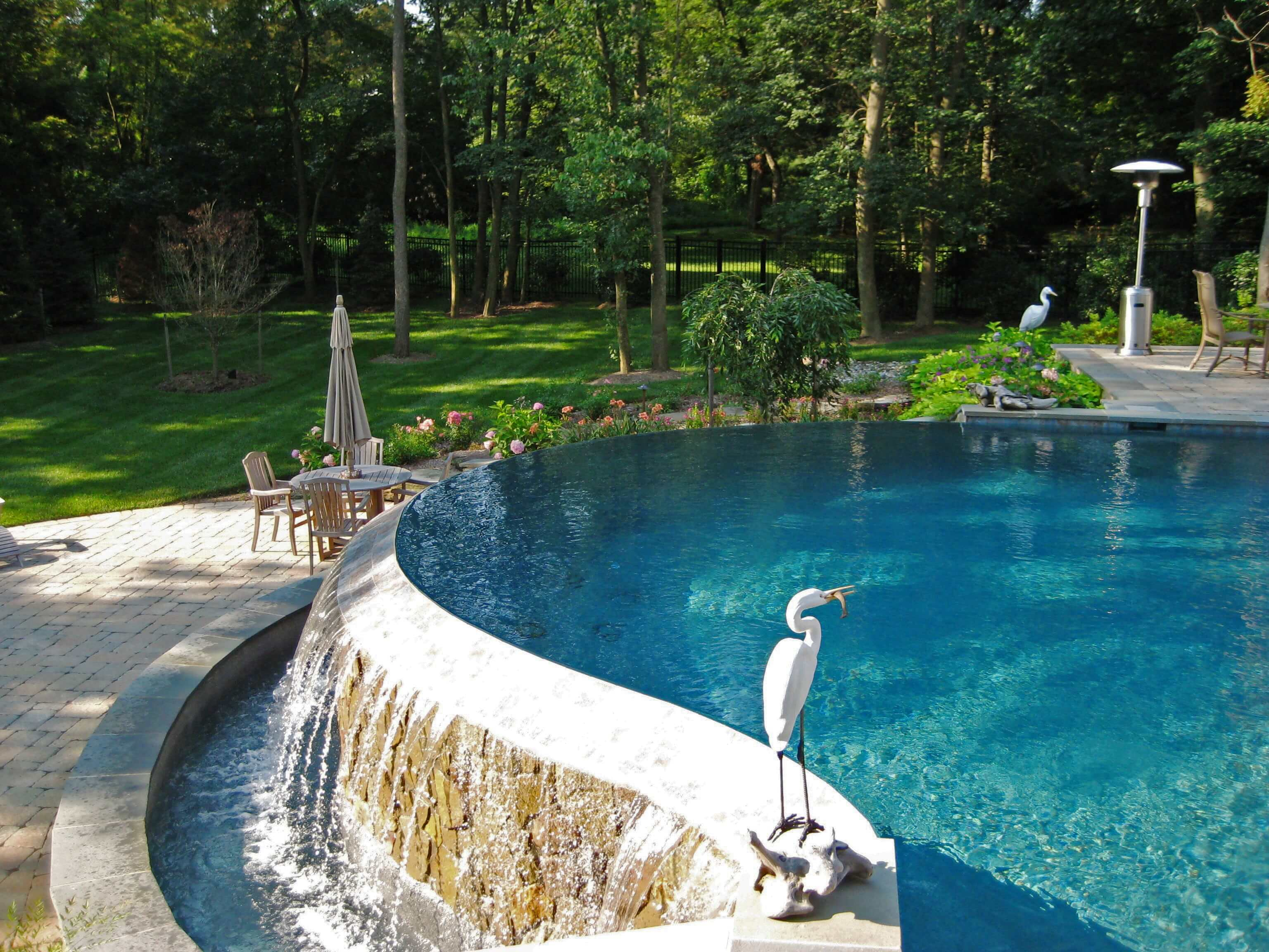 Custom Infinity Pool With Waterfall & Paver Patio