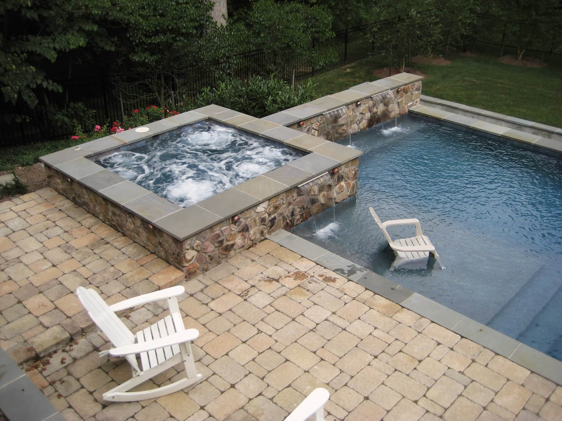 Spa With Pool And Paver Patio