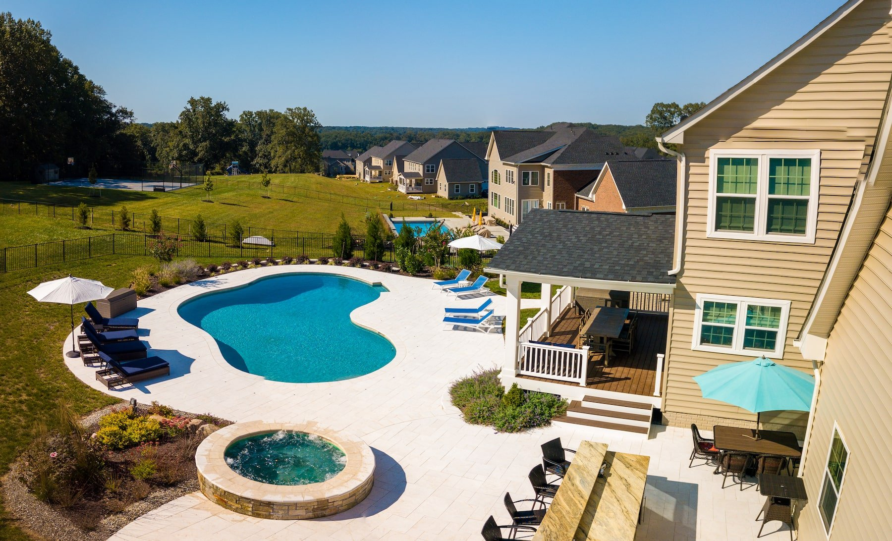 outdoor living space custom pool and spa patio outdoor kitchen deck clarksville md